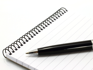 Picture of pen and reporter's notepad